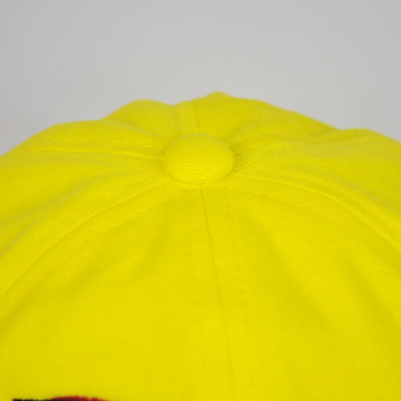 กระดุมหมวกปีกรอบสีเหลืองสด